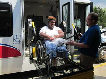 Woman in a Wheelchair Using the Accessible Features of Our Transit Bus
